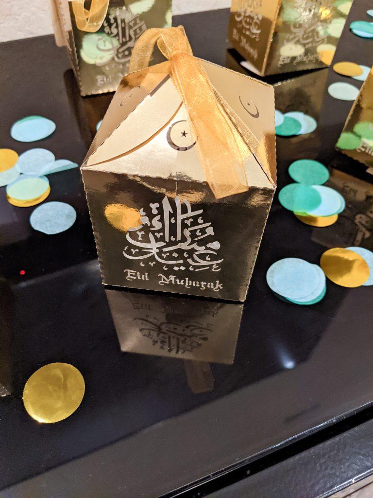 Gold Favor Boxes next to confetti