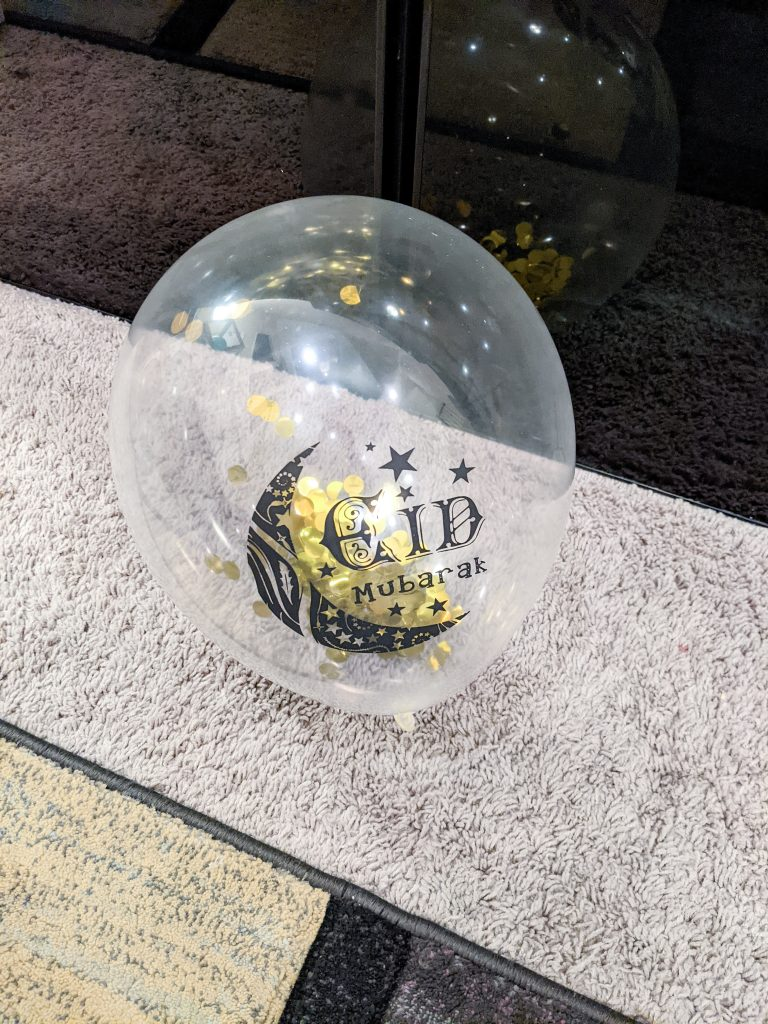 Clear Balloon with gold confetti inside it from the Eid Barakah Box